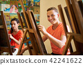 Education In Arts With Happy Student Smiling And Learning Art 42241622
