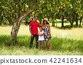 Mother Father And Child Smiling At Camera With Football 42241634