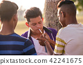 Group Of Teenagers Boy Smoking Cigarette With Friends 42241675