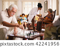 Hospice Doctor Measuring Blood Pressure To Senior Woman 42241956