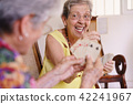 Old Women Enjoy Playing Card Game In Hospice 42241967