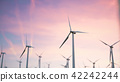 3d illustration of a beautiful, spectacular sunset on a background of wind turbines. Ecological net 42242244