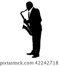 Silhouette of musician playing the saxophone  42242718