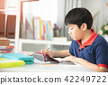 Asian preteens doing your homework with tablet. 42249722