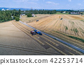 Aerial view on combine harvester working on the large wheat field in Germany 42253714