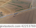 Aerial view on combine harvester working on the large wheat field in Germany 42253769