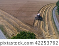 Aerial view on combine harvester working on the large wheat field in Germany 42253792