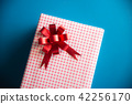 Red gift box on blue background 42256170