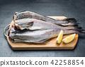 Slave raw Fish on wooden cutting Board  42258854