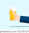 Right hand holding a beer glass  42259724