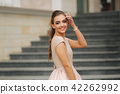 Elegant brunette lady stand on stairs by the hotel 42262992