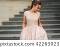 Elegant brunette lady stand on stairs by the hotel 42263023
