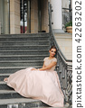 Fashion model sis on stairs by the hotel. Joung girl smile 42263202