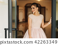 Stylish girl in dress stand in hotel hall. Girl smile to camera 42263349