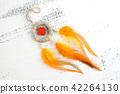 Bright dream catcher with an orange cross 42264130