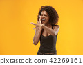 Isolated on red young casual afro woman shouting at studio 42269161
