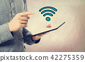 WiFi with man holding a tablet 42275359