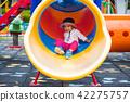 Happy little cute girl having fun and sliding 42275757