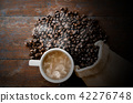 white coffee cup and coffee beans 42276748