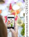 Young girl making food photo at summer picnic 42285253