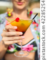 Exotic cocktail glass in womans hand 42285254