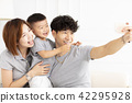 family mother, father and child taking selfie 42295928