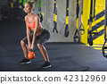 Smiling fit lady is training power in gym 42312969