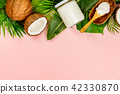 Coconut oil, tropical leaves and fresh coconuts 42330870