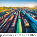 Aerial view of colorful freight trains at sunset. 42333022