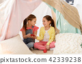 little girl playing tea party in kids tent at home 42339238