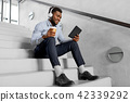 businessman with headphones and tablet pc 42339292