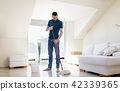 man with mop and bucket cleaning floor at home 42339365