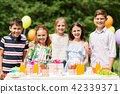 happy kids on birthday party at summer garden 42339371