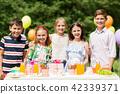 happy kids on birthday party at summer garden 42339371