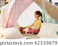 little girl playing tea party in kids tent at home 42339679