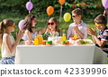 happy kids with cake on birthday party at summer 42339996