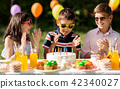 happy kids with cake on birthday party at summer 42340027