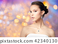 beautiful asian woman with earring and pendant 42340130