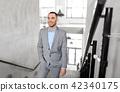 businessman walking upstairs 42340175