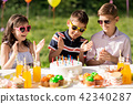 happy kids with cake on birthday party at summer 42340287
