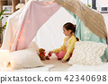 little girl playing tea party in kids tent at home 42340698