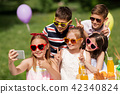 happy kids taking selfie on birthday party 42340824