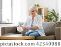senior woman drinking tea at home 42340988