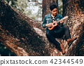 Asian young men play guitar 42344549
