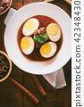 Eggs and pork in brown sauce,Thai Cuisine. 42348430