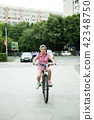 Girl in the park with her bicycle  42348750