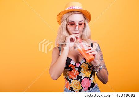 Happy woman drinking orange juice 42349092