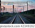 railroad traffic lights and infrastructure sunset 42349162