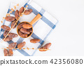 Dates fruit in wooden ladle on white background 42356080