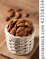 Almond snack fruit in white basket on wooden 42358334